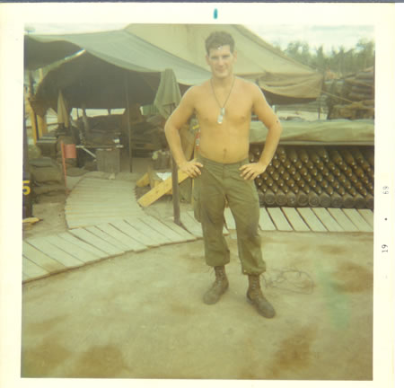 Gela_1969_-_Mercer_in_front_of_our_sleeping_tent.__Dixon_sitting_inside._fs