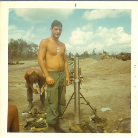 Gela_May_12,_1969_-_82_mm_mortar_and_stuff_grunts_found_in_jungle_after_attack._fs