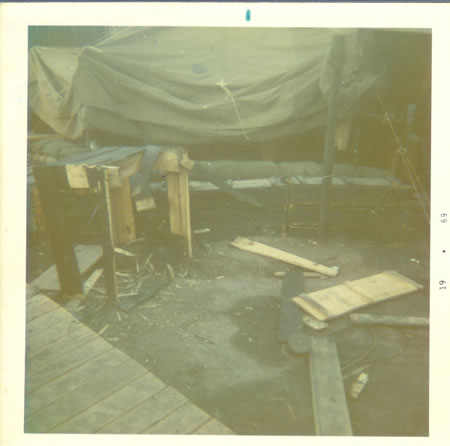 Gela_May_12,_1969_-_Wash_table_outside_of_our_sleeping_tent_hit_by_mortar_fs